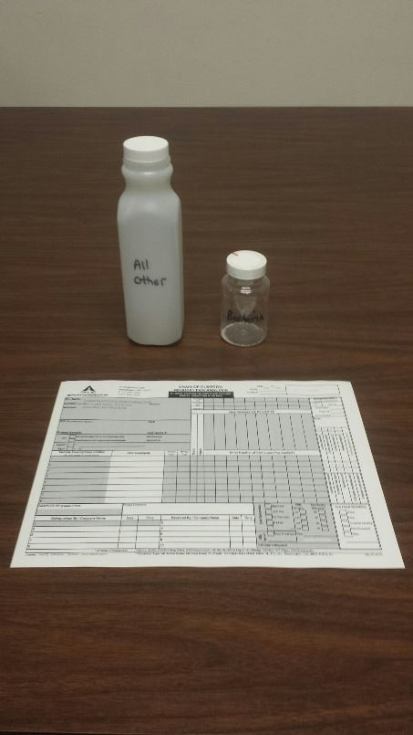 Image of water test bottles and chain of custody document for the water testing service